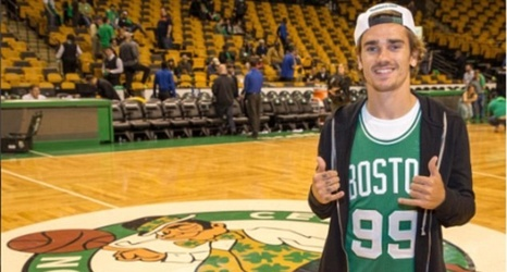93b8566628f8 Manchester United target Antoine Griezmann swaps football boots for basketball  jerseys as he dons Boston Celtics colours at the NBA Finals