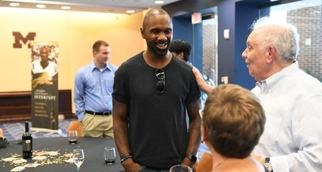 Former Heisman winner Woodson sees national title for Wolverines