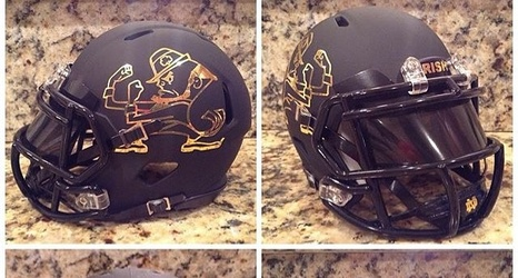 30e0467eb Photos  This Matte Black And Gold Custom Notre Dame Helmet Is Incredibly  Cool